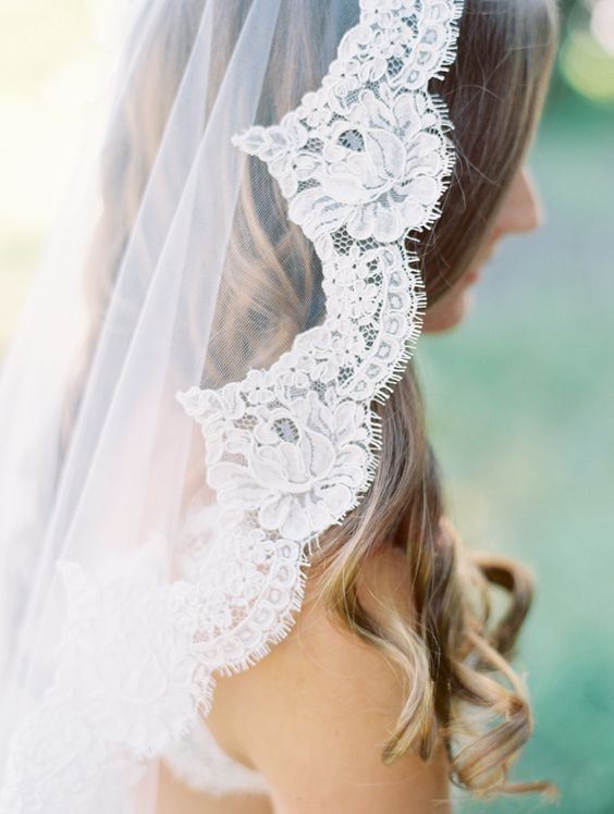"Mantilla (Spanish Lace Veil).  This is the iconic piece of Spanish tradition, made of lace or tulle with a lace trim. Mantillas or ""mantilla"" veils are known for their scalloped or round edge. Come into our Bridal Emporiums to view our selection of stunning lace veils.  #wedding #veil #love"
