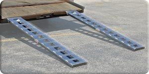 """Our 72"""" car trailer ramps have a 2500 lb. weight capacity per axle (vehicles up to 4500 lbs.) for loading of car trailers, farm equipment or construction equipment. These all aluminum ramps are light weight and will never rust even being kept outside. They are available with a plate end or hook end to attach to most car trailers. These ramps have a wide, serrated cross rung for superior traction"""