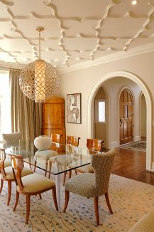 The Large Segmental Arched Opening Of Dining Room Leads To Entry Foyer