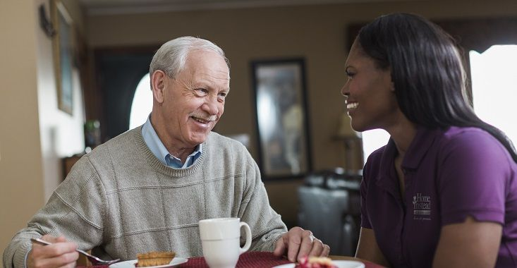 Home Instead CAREGiver eating with senior