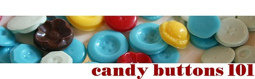"""Create pink and orange buttons. Make packaging that says """"Cute as a Button"""""""