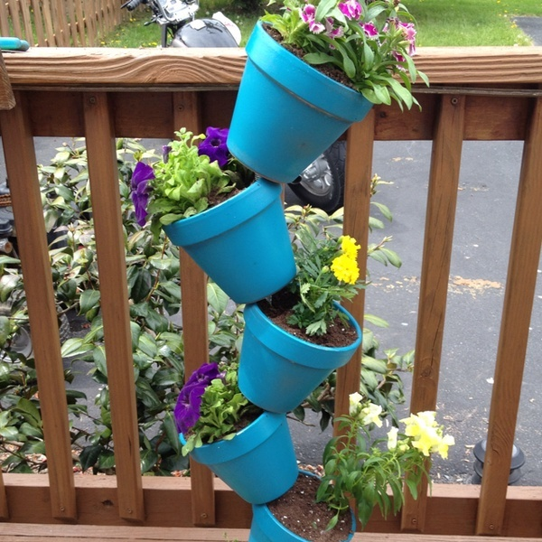 Got the idea from pinterest. This is my creation. Spray painted terra cotta pots and bolted the rod to hold it together on my deck!