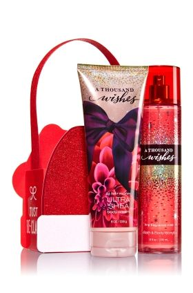 A Thousand Wishes - Just Be-Claus Gift Set - Bath & Body Works - Make her Christmas extra merry with two of her favorites in a cute carrier! Our Ultra Shea Body Cream (8 oz) delivers 24 hours of our best moisture, while Fine Fragrance Mist (8 fl oz) nourishes as it scents skin. These gifts come ready to give in a sparkly Santa-inspired carrier.