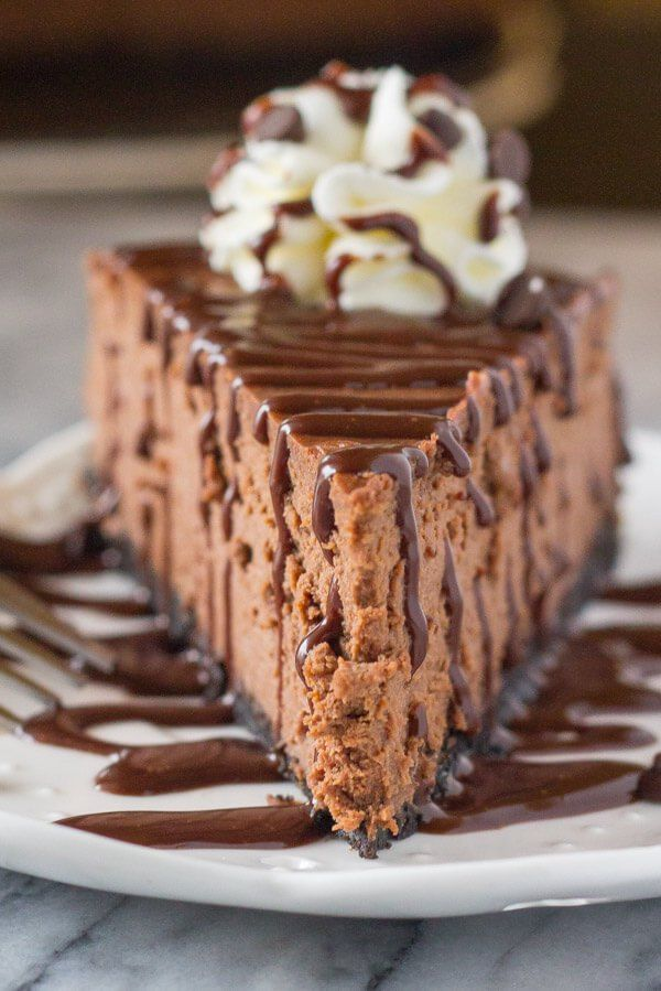 This baked chocolate cheesecake with an Oreo cookie crust is smooth, creamy & perfectly decadent. Then top it with chocolate sauce - and it's chocolate perfection.