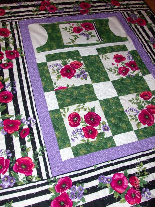 """Find handmade wheelchair quilts from Carolyn's Homesewn in NH. Our signature """"lovie lap quilts"""" feature pockets for extra warmth and storage. Click to shop today!"""