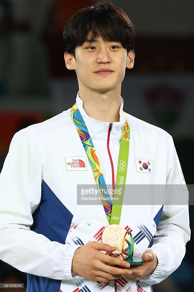 South Korea's Daehoon Lee poses with his bronze medal at the victory ceremony for the men's -68kg taekwondo event at the Rio 2016 Summer Olympic Games, at Carioca Arena 3. Stanislav Krasilnikov/TASS