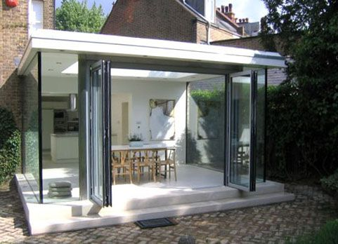 Modern glass extension at the rear of a Victorian family house
