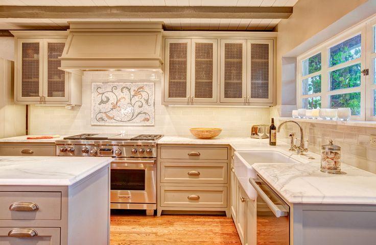 Mother-Of-Pearl-backsplash-beams-Calacatta-marble-calcutta-calcutta-counters-calcutta-marble-slab-cup-pulls-decorative-tile-backsplash-exposed-beams-hardwood-floors-kitchen-hood-Mediterranean-mosaic-tile-backsplash-painted