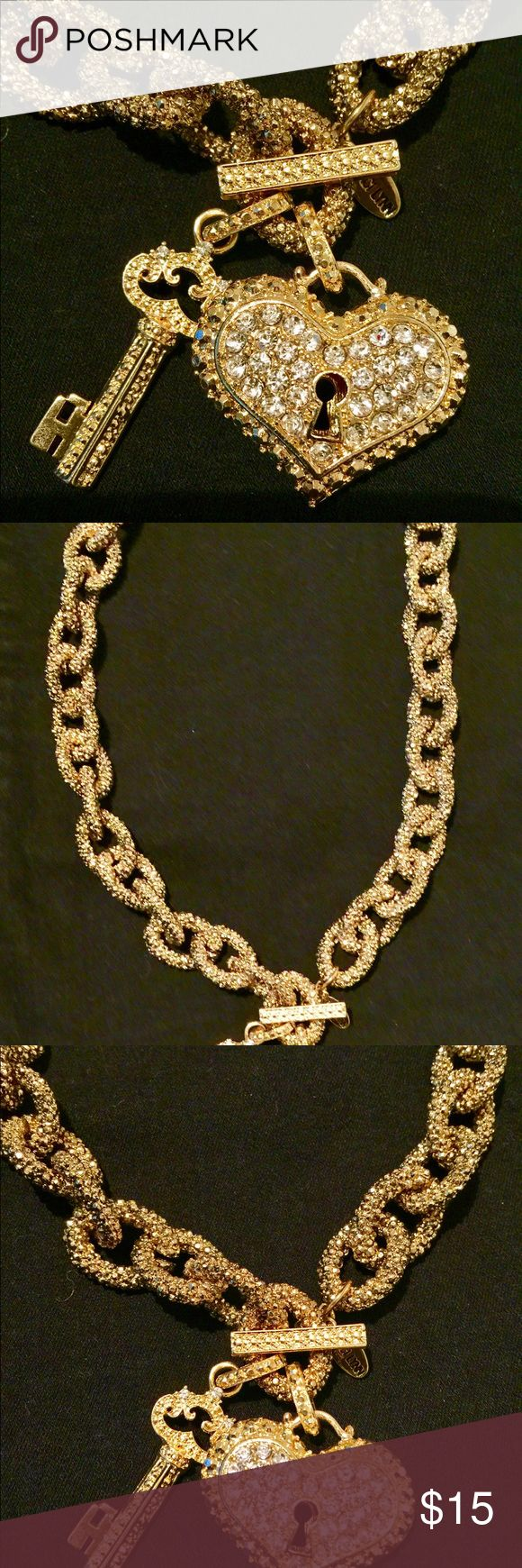 Traci Lynn gold chain choker with charms Gold encrusted link chain choker with a faux diamond encrusted heart and key. Heart shaped earrings. Never worn, no flaws. Traci Lynn Jewelry Necklaces