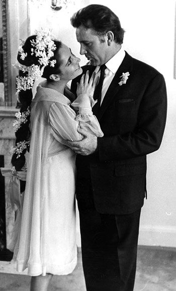 Husband #5: Richard Burton  Year: 1964  Profession: Actor  Details: True to the '60s, Taylor wore a floral wreath made with Roman hyacinths and Lily of the Valley flowers and a babydoll dress to her March wedding. The yellow chiffon dress was designed by Irene Sharaff, the costume designer who worked on Cleopatra.    Taylor met the second great love of her life on set while filming Cleopatra. It was the most expensive movie of all time but their romance overshadowed the price tag.