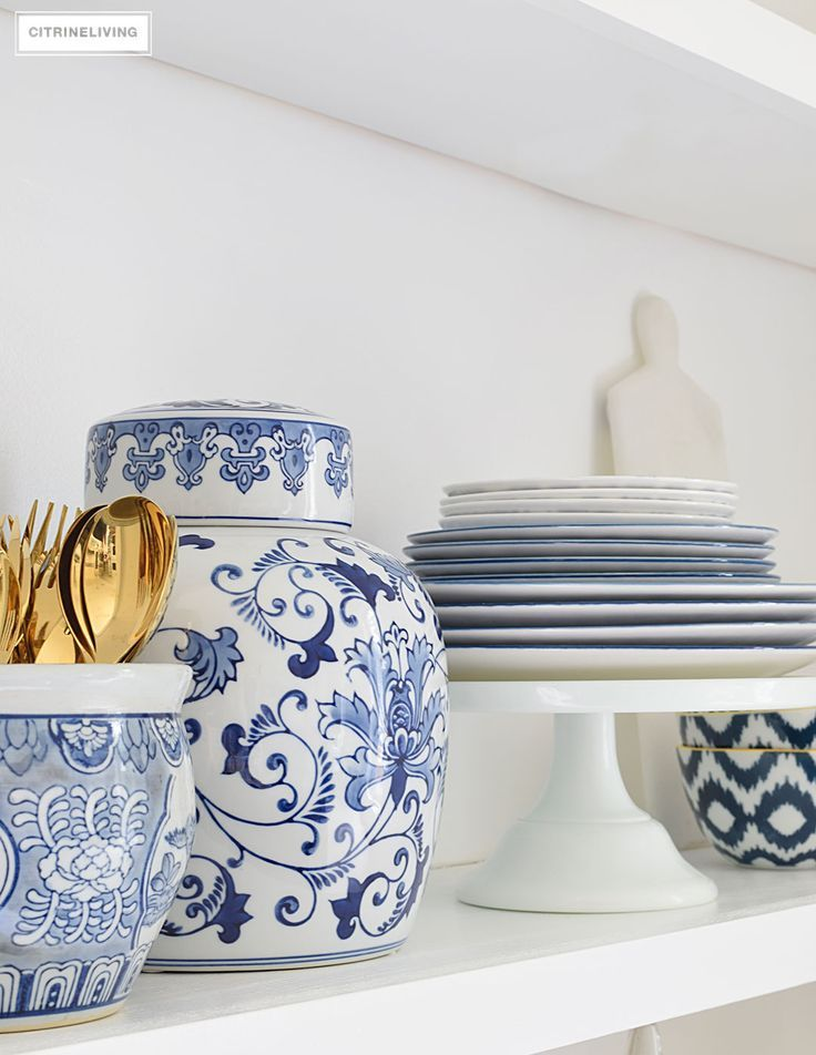 Create the perfect shelf display with blue and white accessories.