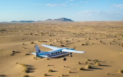 The adventure capital of Namibia: Swakopmund. How about driving in an open vehicle with a throbbing V8 motor plunge down the sides of the dunes? #namibia #adventure #travel