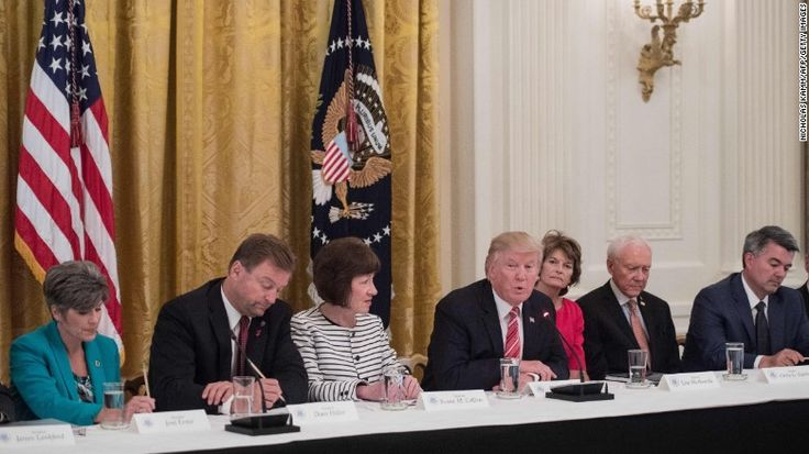 Bullying the Women: President Trump with, from left, US Sens. Joni Ernst of Iowa, Dean Heller of Nevada, Susan Collins of Maine, Lisa Murkowski of Alaska,  Orrin Hatch of Utah  and Cory Gardner of Colorado as Republican senators meet with Trump to discuss the health care bill.