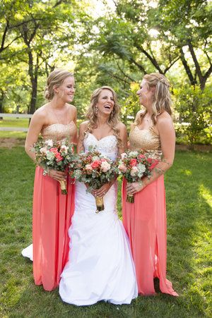 Bridesmaid separates are trending, and these bridesmaid dresses definitely give the appearance of these. With a gold sparkling bodice and sheath coral skirts, this strapless bridesmaid dress option is so fitting for a hot summer wedding. | Venue at the Grove in Phoenix, AZ