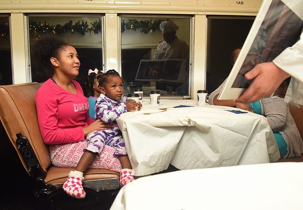 Tori Stephens and Ivory Edwards, 2, of Palestine, look at pages from the Polar Express book during the Polar Express train ride at the Texas State Railroad in Palestine Monday Nov. 15, 2016. The hour long Polar Express trip runs Nov. 18-22, 25-27; Dec. 2-4, 9-11, 13-23. (Sarah A. Miller/Tyler Morning Telegraph)