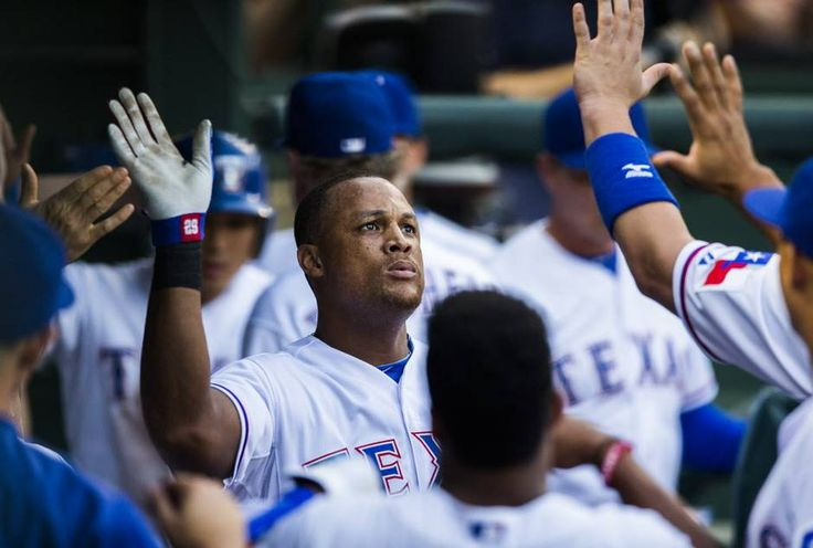 Texas Rangers third baseman Adrian Beltre (29) gets high fives from team mates in the dug outs after Beltre hits a home run during the first inning of their game against the Toronto Blue Jays on Wednesday, August 26, 2015 at Globe Life Park in Arlington, Texas. (Ashley Landis/The Dallas Morning News)