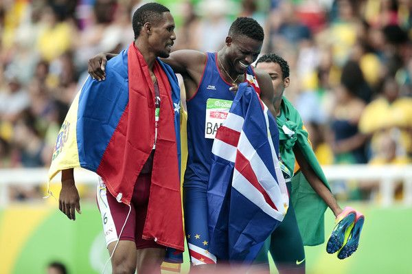 (L-R) Luis Arturo Paiva of Venezuela, Gracelino Barbosa of Cape Verde and Daniel Martins of Brazil celebrate after the Men's 400m - T20 Final at the Olympic Stadium on Day 2 of the Rio 2016 Paralympic Games on September 9, 2016 in Rio de Janeiro, Brazil.