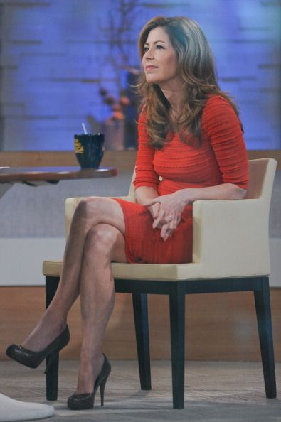 Dana Delany. long dark brown hair, blonde highlights, naturally curly. hmmm, should I grow my hair back out?