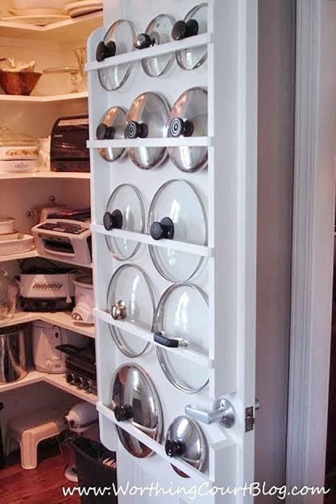 Neatly store lids for pots and pans with built-in racks. #organizing #pantry #womansday