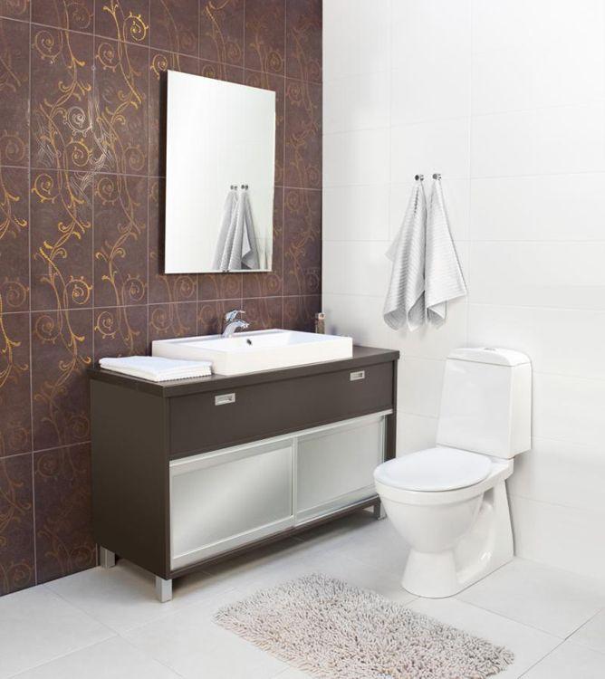 Mittatilauksena valmistettu wc -kaluste, väri grafiitinharmaa, liukuovien kehykset alumiinia. Liukuovilla saadaan lisätilaa wc -istuimen sijainnista huolimatta.