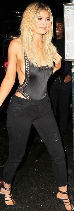 Kylie Jenner : Bracelet – Cartier  Swimwear – Norma Kamali