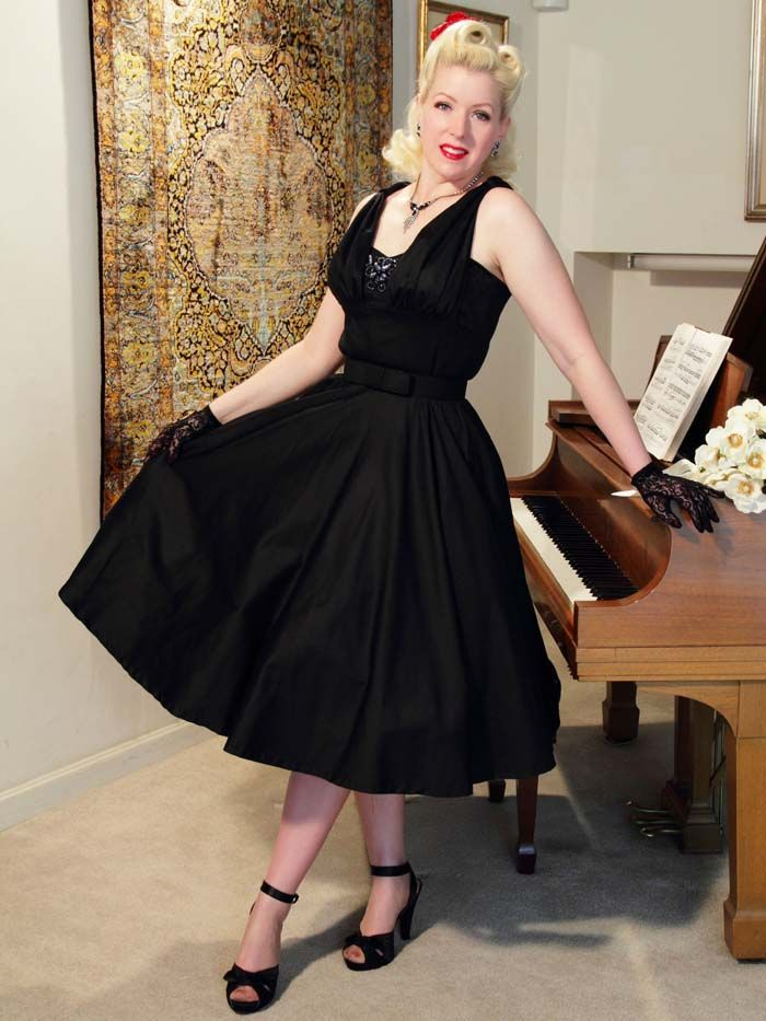 Black 50s Style Class Act  Party Dress with full circle skirt and beaded bodice.  From the Classic Dame line at Blue Velvet Vintage.  Fine quality construction and fabrics. Made In USA. Sizes from 34 bust 27waist to 42 bust 34 waist.  165.00