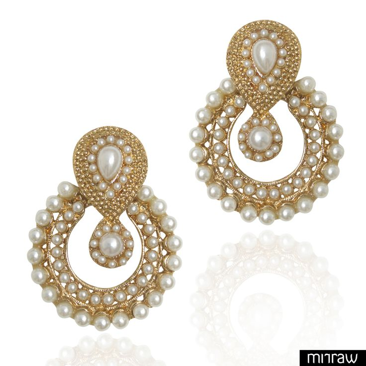 Pearl earring set in a traditional shape glows with warmth of pearls and the ethnic flavour of designs.