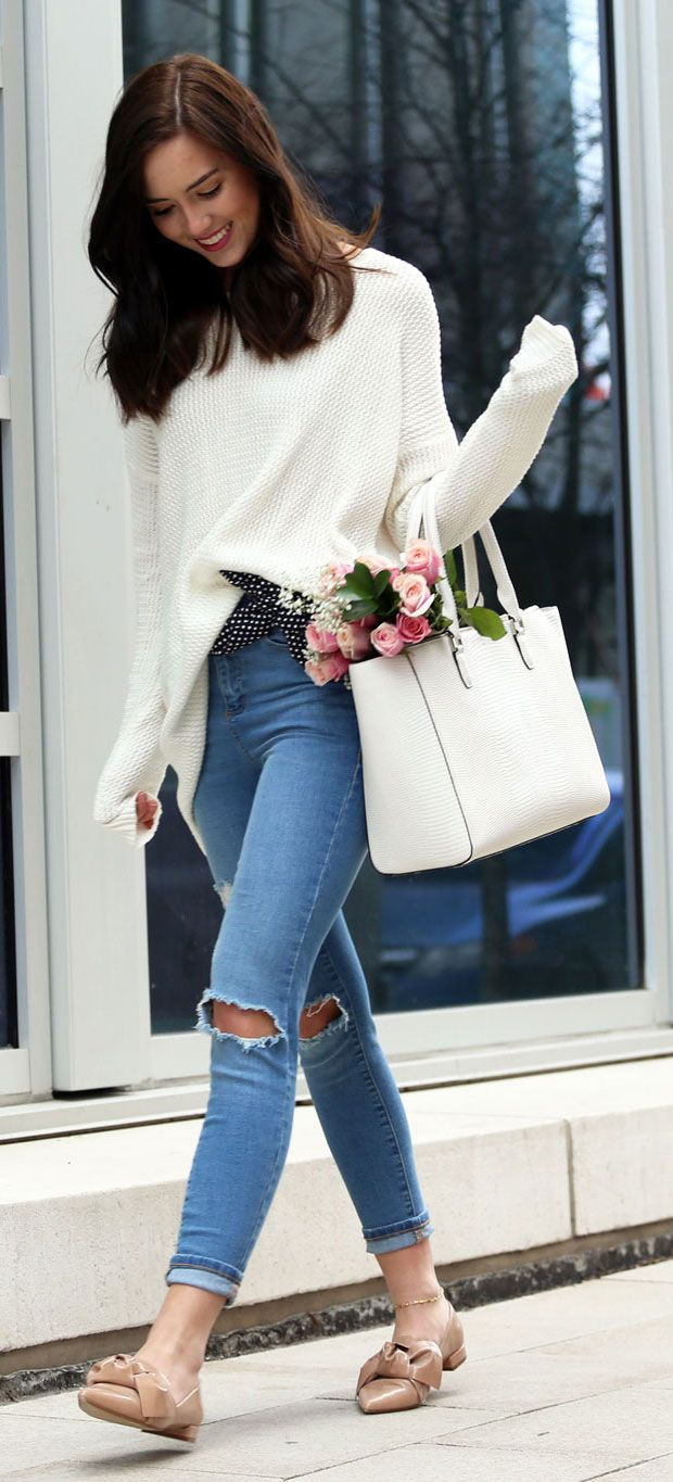 Spring casual look with oversized sweater, bow flats, ripped skinny jeans and leather white tote