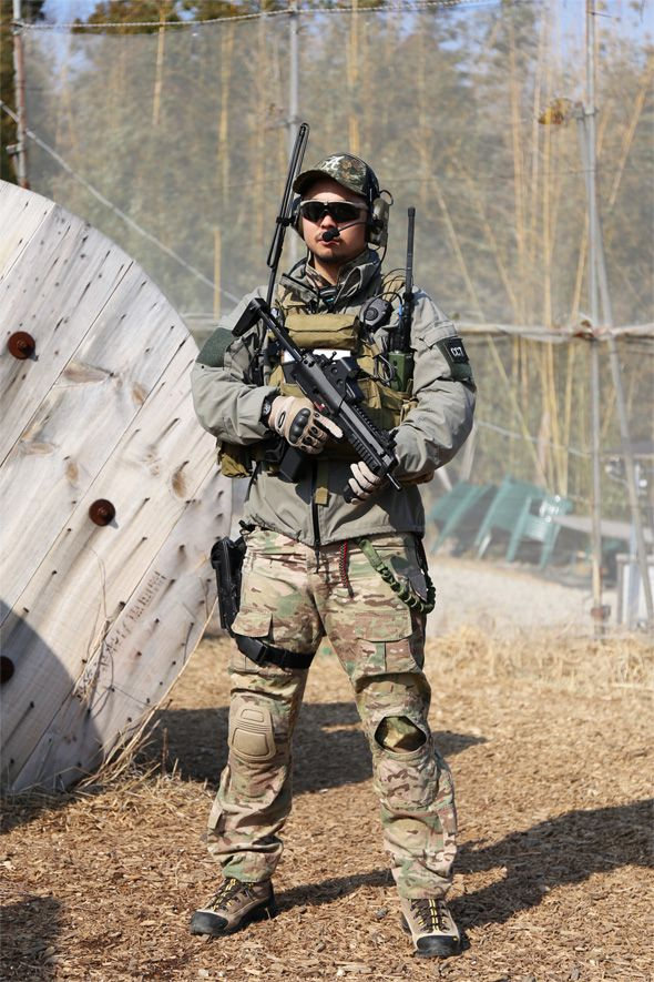 Airsoft Player in Japan. Fashion Photo. Multicam camo BDU ...