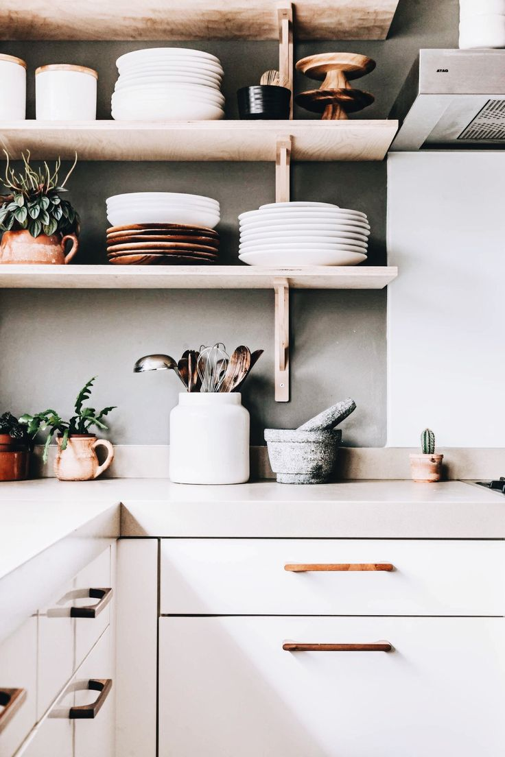 Stack plates on shelves to give the kitchen more dimension