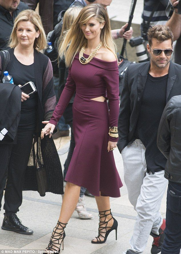 A cut above: Attending an outoor The Voice finalists concert at the Museum Of Sydney on Thursday, Delta Goodrem wore a striking cut out dress that revealed a healthy dose of skin