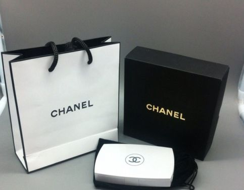 Chanel power bank that opens up to a mirror. 6500 mAh. Comes with cable to charge power bank only! Has universal usb port so it can charge all iphones and androids!