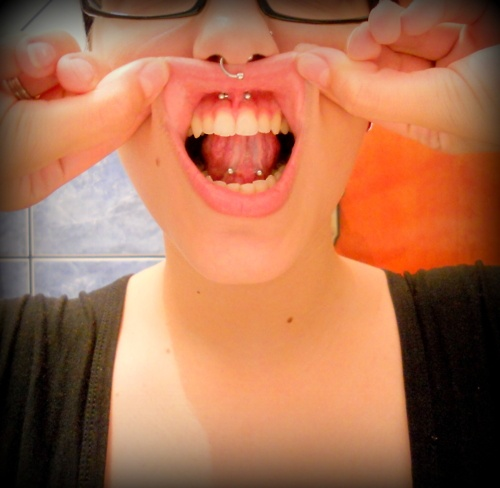 how to know if my tongue piercing is healed