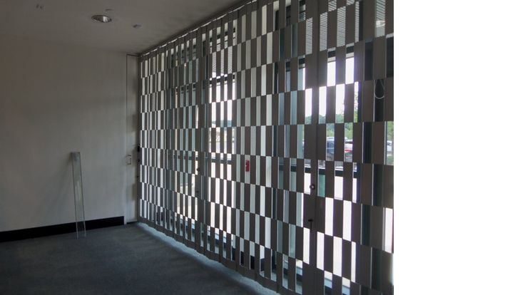 1212 security curtain with push out egress.