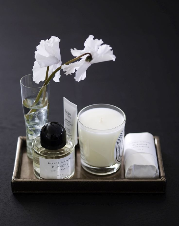 Dyptique candle and Byredo perfume.