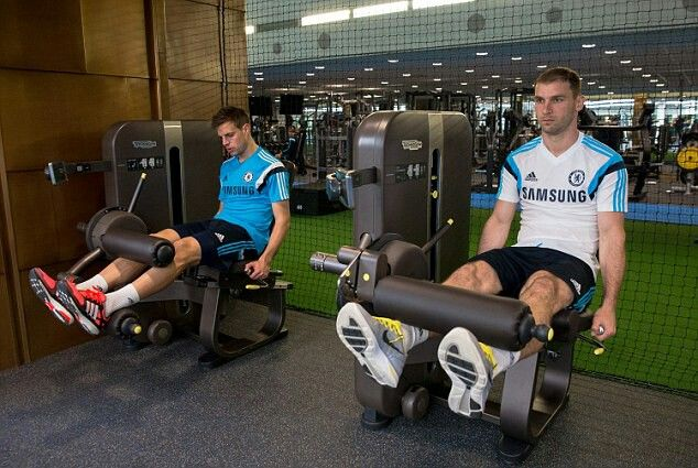 16 April 2014: CESAR AZPILICUETA and BRANISLAV IVANOVIC take part in some leg stretching exercises using new equipment at Cobham...