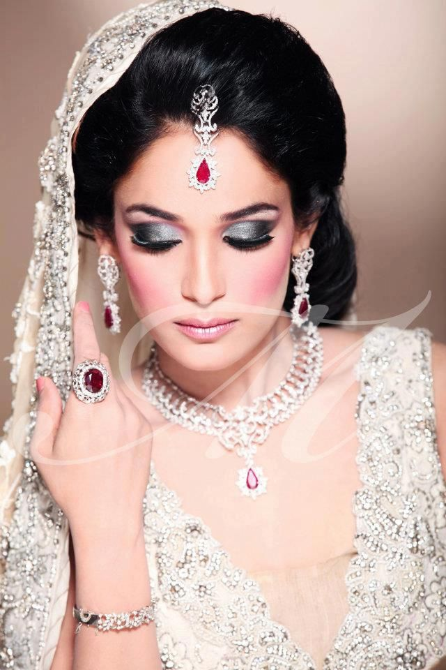 Pakistani bridal makeup is always super dramatic. Especially the eyelids are CAKED with shimmer and glitz!