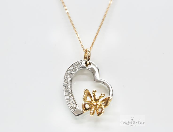 Heart shaped 18k white gold pendant set with diamonds and a yellow 18k gold butterfly.  Perfect for the little girl still in you.