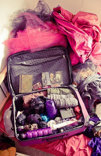 Packing tips & how to roll your clothes so they take up less space - and don't forget a couple of Space Bags for dirty laundry!