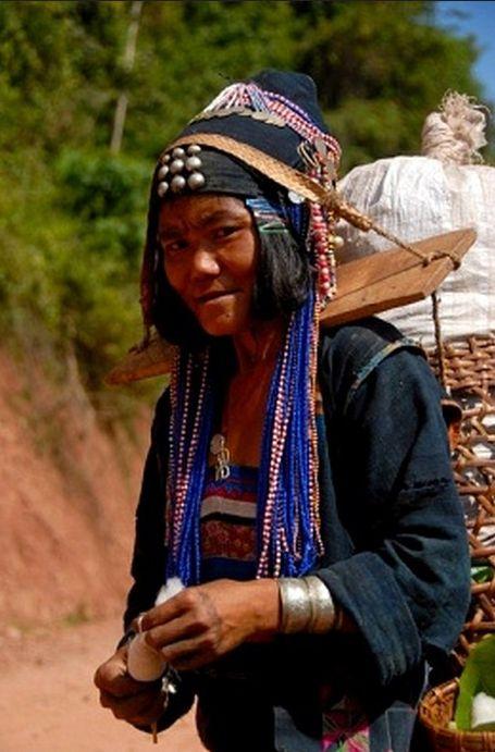 Laos | Akha Djepia woman, carrying a load on a yoke on her shoulders.  Ban Khay, Boun Tai district, Phongsali province. | © Stefan Auth