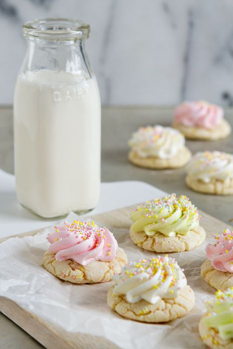 Super easy cake mix cookies are given a festive Easter twist with the addition pastel buttercream and sprinkles.