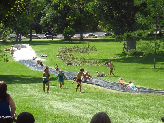 tarp slip n slide even though i got hurt on one of these at a party i had the most fun of my life on it all you need is a hill