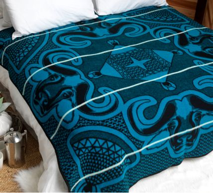 "Linare Basotho Blanket (Limited Edition). The ""Linare"" genuine Basotho Blanket design includes a combination of the African Buffalo and the ""Mokorotlo"" - the famous Lesotho hat, said to be inspired by the Mountains of Lesotho. It is an exceptionally striking and beautiful design and was recently created when King Letsie 3rd held his birthday celebrations in the village of Leribe. The Linare or Buffalo is the icon for the town of Leribe and was thus an important symbol in the design."