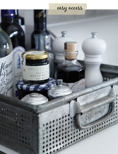 store frequently used items next to the stove in a pretty container