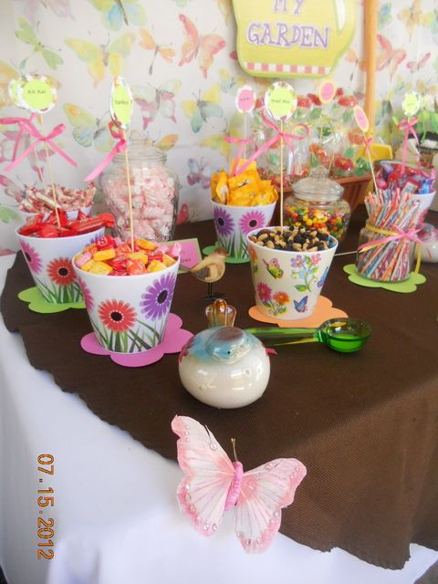 For a cute garden party idea, present treats in flower pots - everything from wrapped candies to trail mix looks cuter in a flower pot!