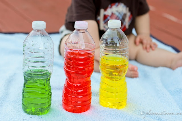 It doesn't get much easier than colored water bottles for baby to play with.