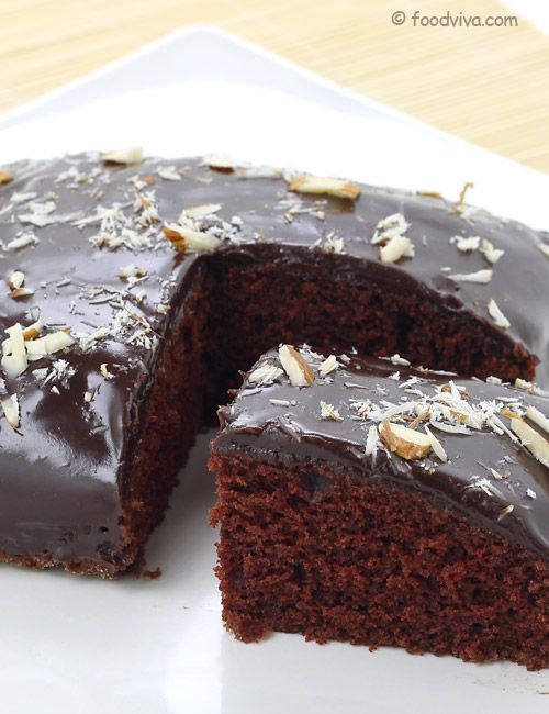 This Eggless Chocolate Cake Recipe Explains How To Make Soft and Spongy Chocolate Cake Without Using Eggs and Condensed Milk At Home With Step By Step Photos. It Also Explains How To Make Chocolate Ganache and Use It As a Cake Frosting.