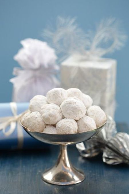 Danish wedding cookies placed in a footed dish takes your favors to the next level.  See more wedding cookie favor ideas at one-stop-party-ideas.com