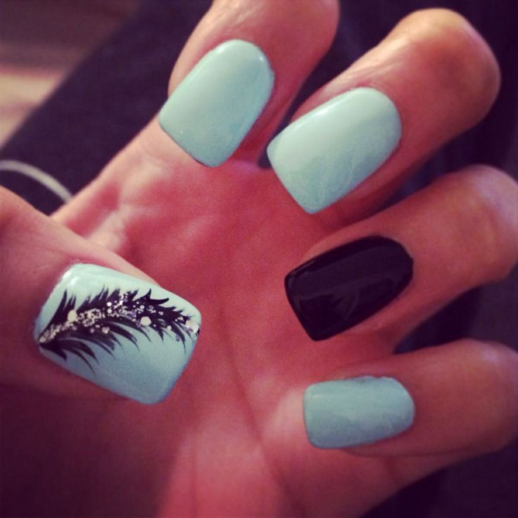 Pretty light blue and black nail art with black glittery feather