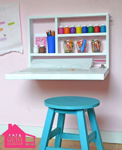 """hide-away art desk Make a larger version on garage wall for gift wrapping station! Could also put them under kids loft beds so their """"homework"""" desk folds away for play time."""